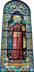 Sainte Thècle tient à la main les trois doigts de Saint Jean Baptiste qu'elle a rapporté